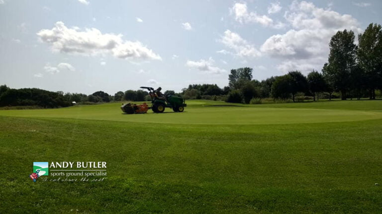 Autumn renovation and maintenance of golf green, Ferndown, Dorset, August 2019